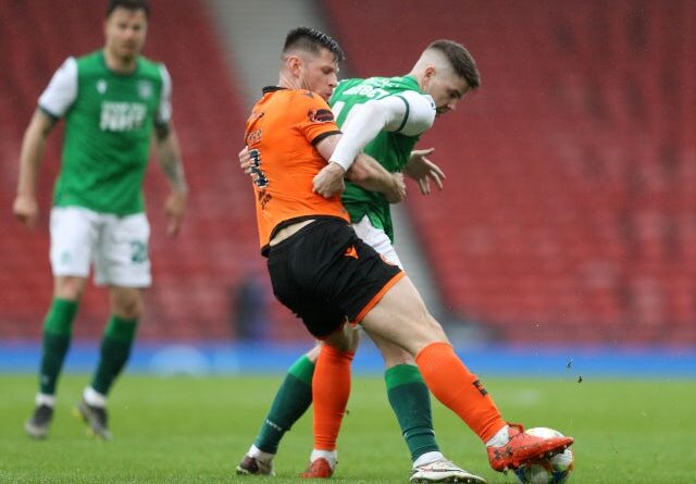 Dundee United's Calum Butcher in action with Hibernians Kevin Nisbet in the Scottish FA Cup on May 8, 2021