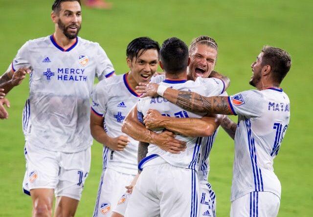 FC Cincinnati midfielder Luciano Acosta celebrates with his teammates who scored a goal on June 27, 2021