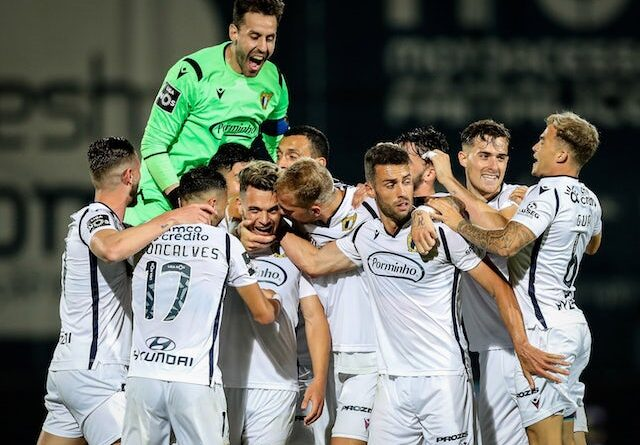 Famalicao's players celebrate after scoring against Porto on June 3, 2020