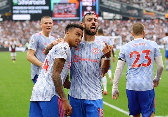 Manchester United's Jesse Lingard celebrates a goal with Bruno Fernandes against West Ham United on September 19, 2021