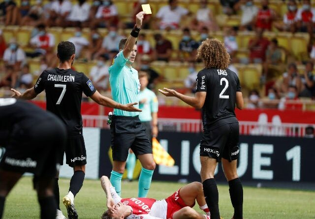 Wout Faes is booked for Reims against Monaco in Ligue 1 in August 2020