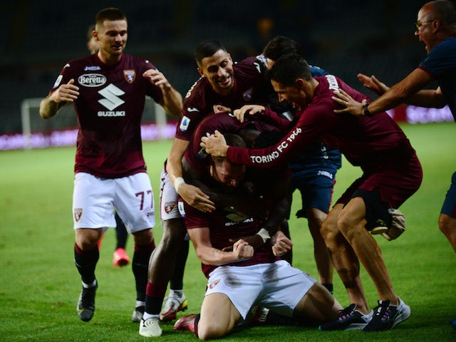 Torinos Andrea Belotti will celebrate his first goal with his teammates on August 21, 2021